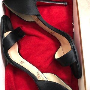Woman's black silk heels